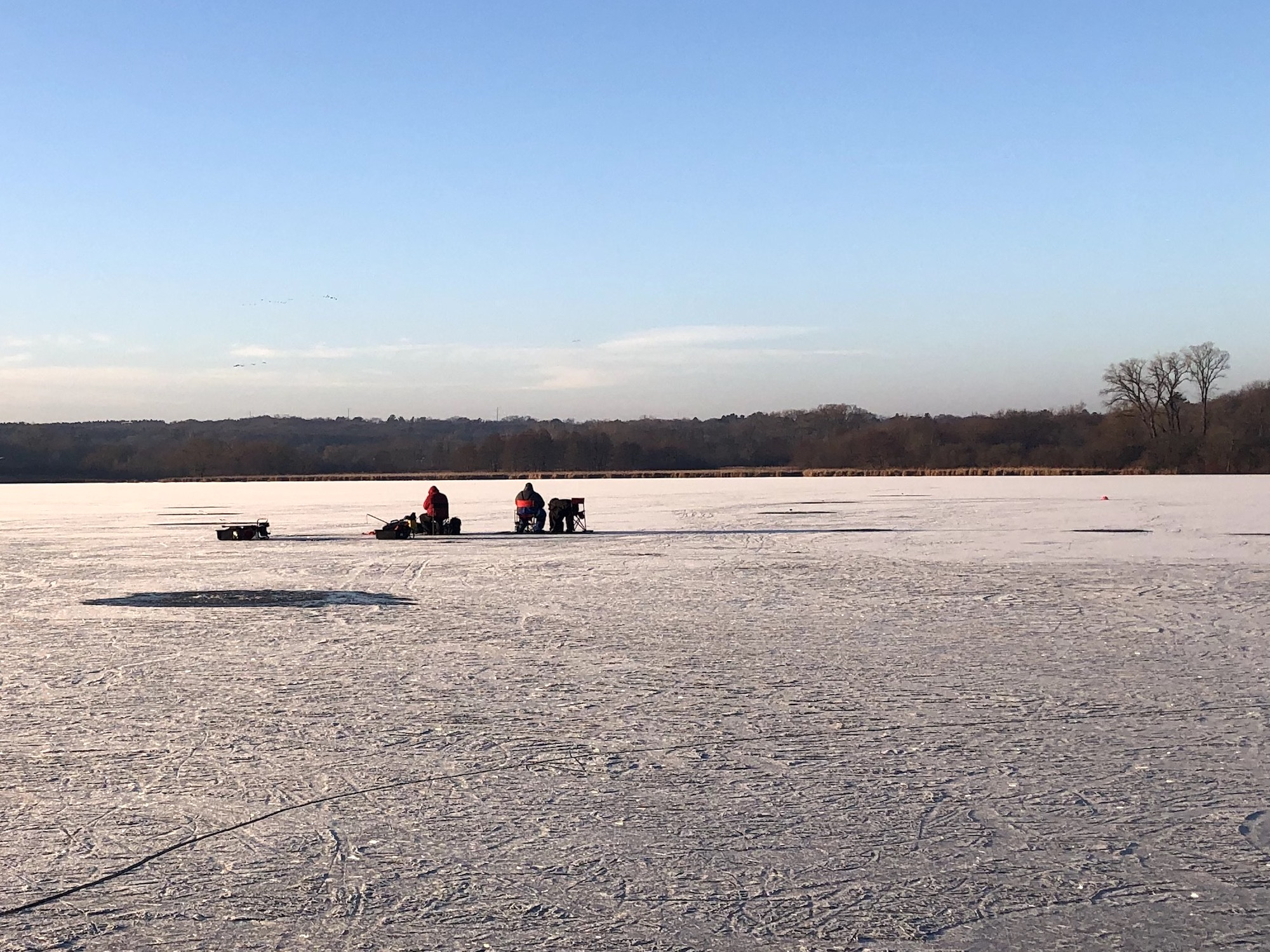 Ice fishermen on Lake Wingra on December 22, 2019.